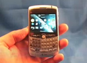 Hand holding a BlackBerry Curve Smart Phone