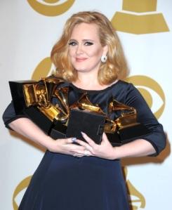 Adele holding six Grammy's